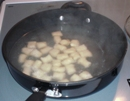 Gnocchi pieces being poached